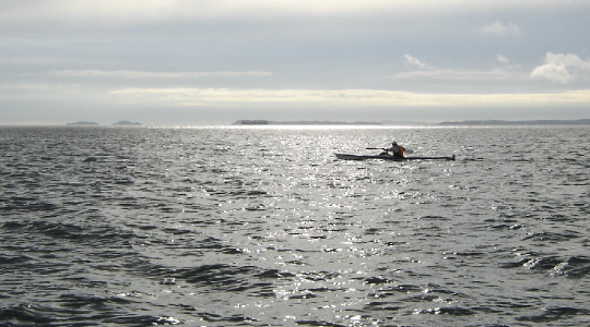Steve Horne kayaks past Rangitoto Island