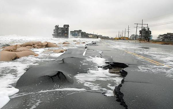 North Carolina road damage, 5-story beachfront house exposed