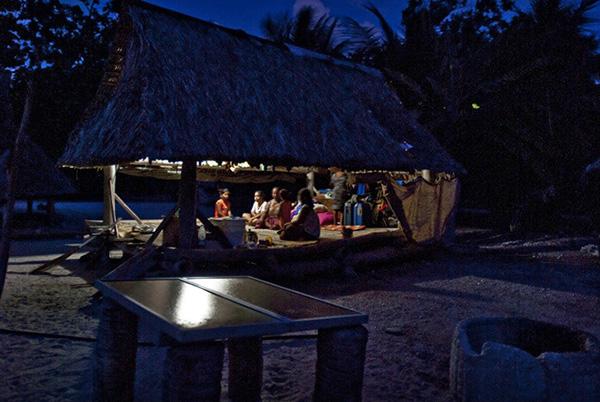 Tarawa family, lit with photovoltaic power