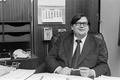 David Lange, seated at desk