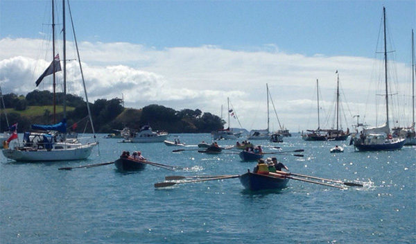 St Ayles skiffs arriving at Sullivans Bay