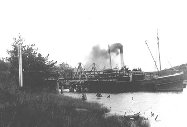 Steamboat Kotiti passing the Pūhoi swing bridge pre-1924
