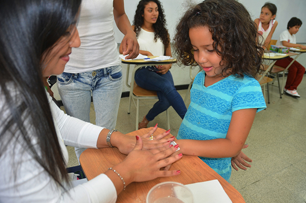 Child receiving tatoo transfer after voting in Costa Rica, 2014
