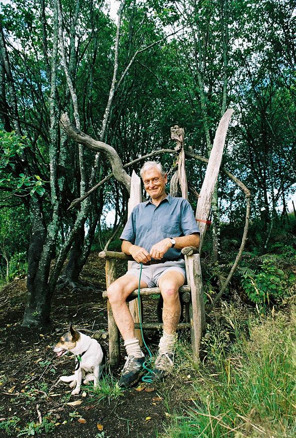 Jaap van Dorsser seated on rustic throne