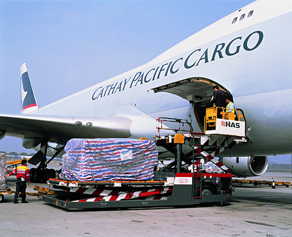 Infant formula, presumably, being loaded aboard a Cathay Pacific air freighter