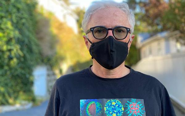 Professor Michael Baker, masked
