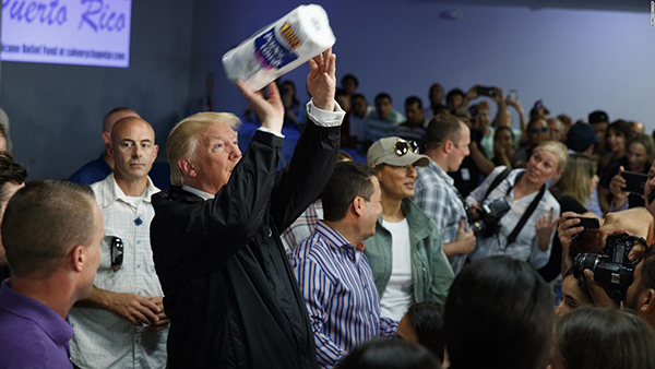 Donald Trump tossing rolls of paper towels to Puerto Ricans